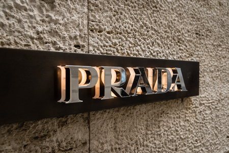 Milan, Italy - October 8, 2016: Logo of a Prada shop in Milan - Montenapoleone area, Italy. Few days after Milan Fashion Week. Fall Winter 2017 Collection.