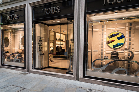 Milan, Italy - October 8, 2016: Window and entrance of a Tods shop in Milan - Montenapoleone area, Italy. Few days after Milan Fashion Week. Fall Winter 2017 Collection.