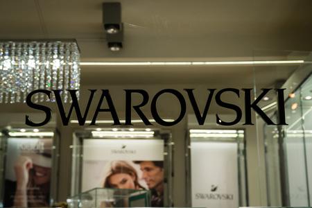 Monza, Italy - February 28, 2017: Shop window of a Swarovski shop in Monza. Swarovski logo