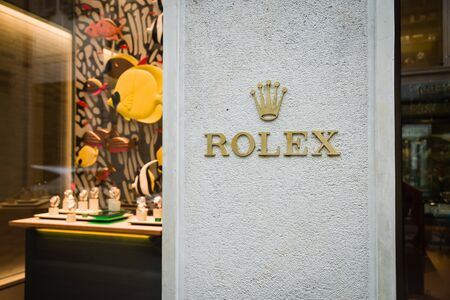 Milan, Italy - February 28, 2017: Shop window of a Rolex shop in Milan - Montenapoleone area, Italy. Few days after Milan Fashion Week. Spring Summer 2017 Collection. Rolex logo
