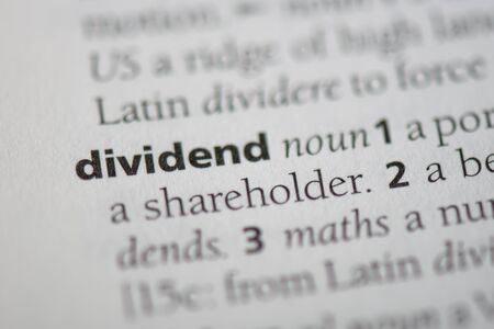 dividend word in a dictionary. dividend concept