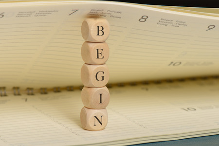 Begin word on wooden cubes. Begin concept