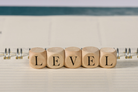 Level word on wooden cubes. Level concept Stock Photo