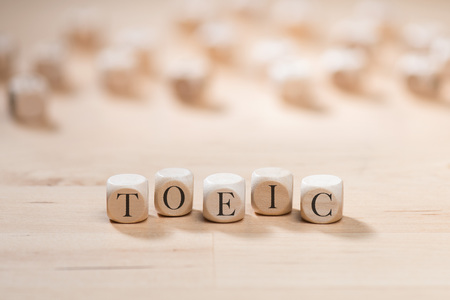 Toeic word on wooden cubes. Toeic concept 写真素材