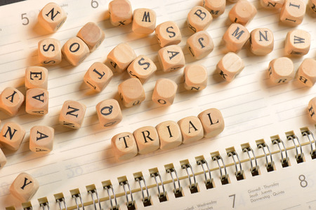 Trial word on wooden cubes. Trial concept