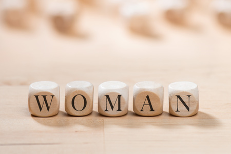 Woman word on wooden cubes. Woman concept Stock Photo