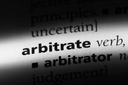 arbitrate word in a dictionary. arbitrate concept. Stock Photo