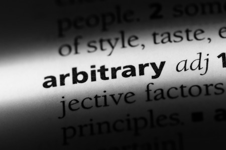 arbitrary word in a dictionary. arbitrary concept.