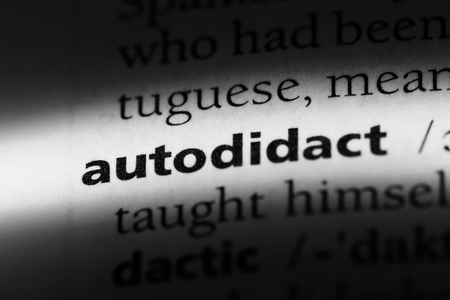 autodidact word in a dictionary. autodidact concept.