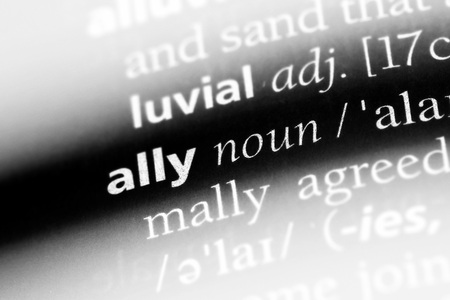 Palabra aliada en un diccionario. Concepto de aliado. Foto de archivo