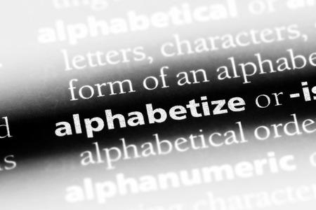 alphabetize word in a dictionary. alphabetize concept. Banco de Imagens