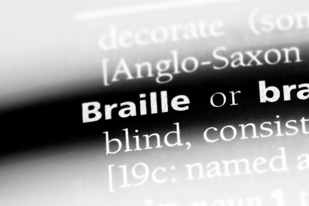 braille word in a dictionary. braille concept.