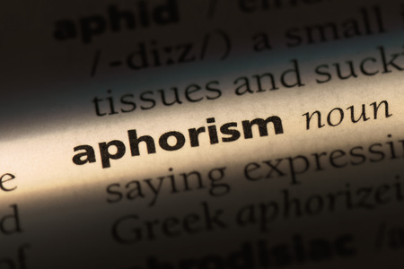 aphorism word in a dictionary. aphorism concept.