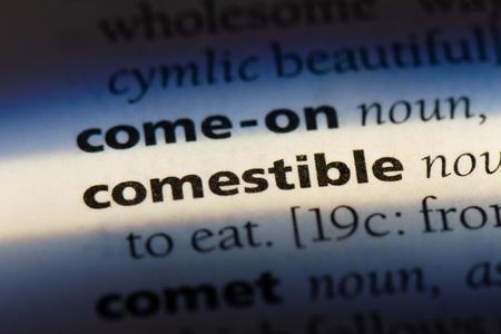 comestible word in a dictionary. comestible concept. Banco de Imagens