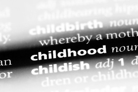 childhood word in a dictionary. childhood concept