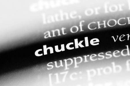 chuckle word in a dictionary. chuckle concept Stock Photo