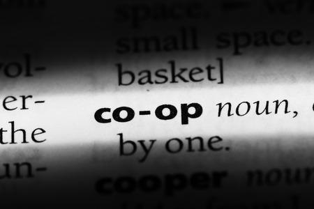 co-op word in a dictionary. co-op concept Banco de Imagens