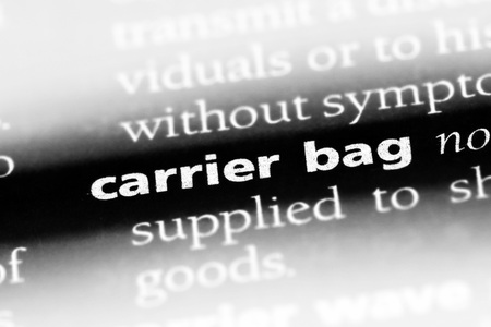 carrier bag word in a dictionary. carrier bag concept Фото со стока