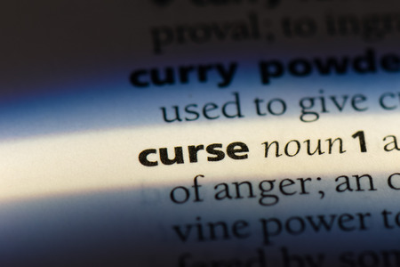 curse word in a dictionary. curse concept