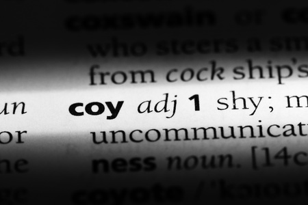 coy word in a dictionary. coy concept Stock Photo