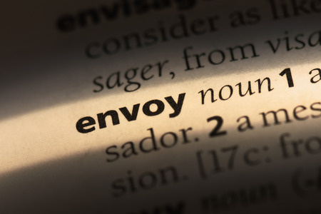 envoy word in a dictionary. envoy concept Фото со стока