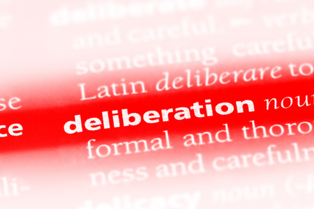 deliberation word in a dictionary. deliberation concept