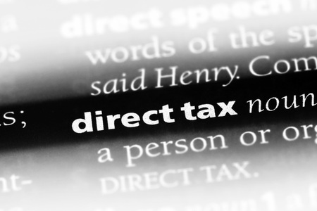 direct tax word in a dictionary. direct tax concept 版權商用圖片