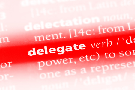 delegate word in a dictionary. delegate concept Stock Photo