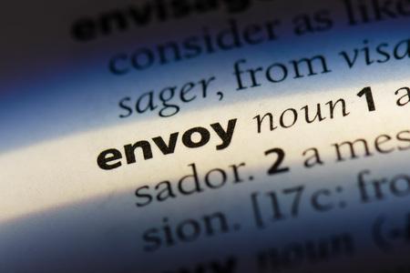 envoy word in a dictionary. envoy concept Фото со стока