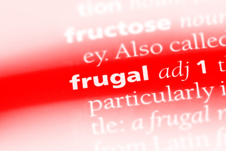 frugal word in a dictionary. frugal concept Archivio Fotografico - 100443309