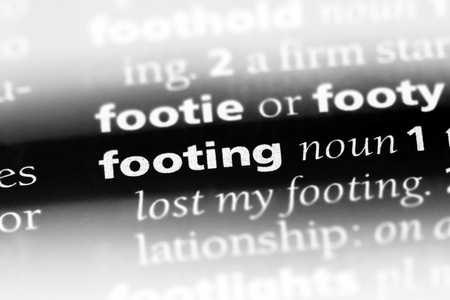 footing word in a dictionary. footing concept Stock Photo