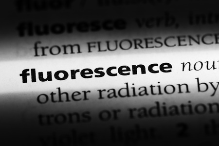 fluorescence word in a dictionary. fluorescence concept