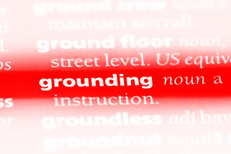 grounding word in a dictionary. grounding concept Stock Photo