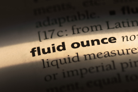 fluid ounce word in a dictionary. fluid ounce concept Stock Photo