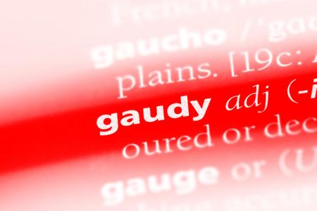 gaudy word in a dictionary. gaudy concept Banco de Imagens