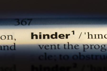 hinder word in a dictionary. hinder concept. 版權商用圖片