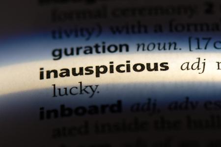 inauspicious word in a dictionary. inauspicious concept. 版權商用圖片