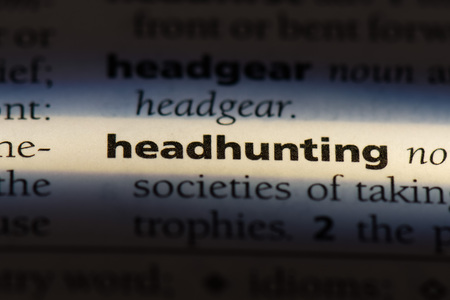 headhunting word in a dictionary. headhunting concept.