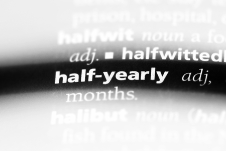 half-yearly word in a dictionary. half-yearly concept.