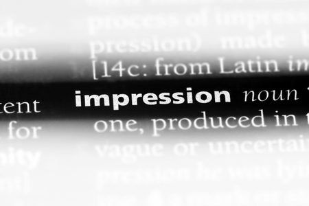 impression word in a dictionary. impression concept. Фото со стока
