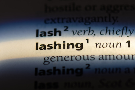lashing word in a dictionary. lashing concept.