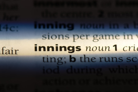 innings word in a dictionary. innings concept. Фото со стока