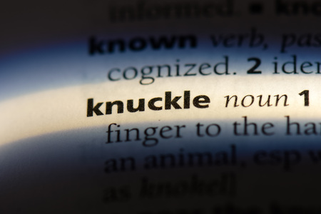 knuckle word in a dictionary. knuckle concept. Foto de archivo