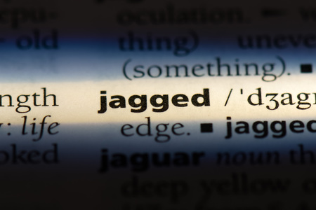 jagged word in a dictionary. jagged concept. Reklamní fotografie