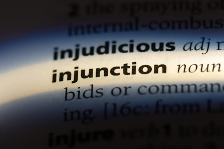 injunction word in a dictionary. injunction concept.
