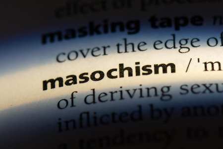 masochism word in a dictionary. masochism concept.