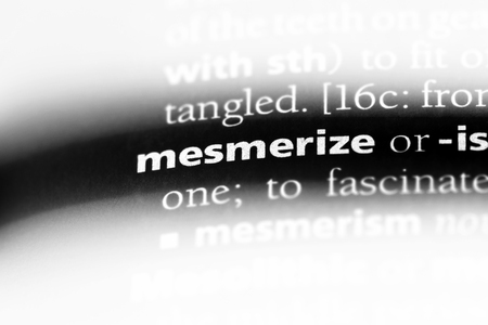 mesmerize word in a dictionary. mesmerize concept. Stock Photo
