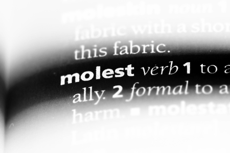 molest word in a dictionary. molest concept.