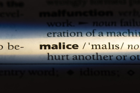 malice word in a dictionary. malice concept. Banco de Imagens
