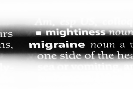 migraine word in a dictionary. migraine concept.